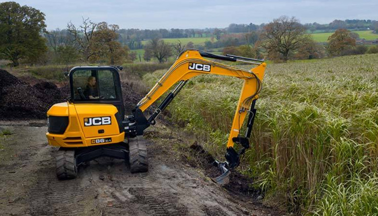 JCB 86c-1 Mini Excavator working in a field